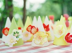 Caroline's 1st birthday party / paper flower party hats / photo by Leah McCormick