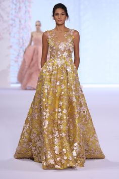 Metallic yellow organza gown with nude tulle overlay, appliquéd with yellow silk organza and rose gold laser cut taffeta flowers. | Ralph & Russo S/S 2016