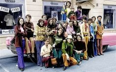 Osama Bin Laden is second from the right in a green shirt and blue pants: