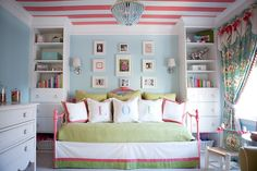 Big girl room: melon pink, pear green, robin's egg blue. Daybed, girly curtains, white built-ins.