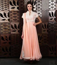 Baby pink net Anarkali with embroidered yolk.