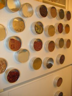 Spices in tins + magnets = fantastic idea! Would be good for back of cabinet door.