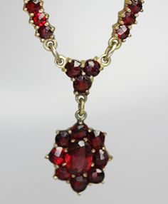 "garnet necklace  From what I have been told, the garnet was a favorite in the Victorian times...it being the ""faux ruby"""