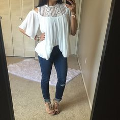 White flowy lace boho chic top Brand new without tags. LOVE this adorable top! Featured lace on the high neck and back. This top is lined so it is NOT see through. Also available in Black will easily fit a small and medium. ❌NO TRADES❌ Tops