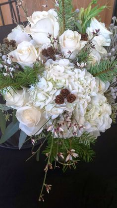 White, winter wedding bridal bouquet. Winter Bouquet, Town And Country, Floral Designs, Evergreen, Bouquets, Floral Wreath, Wreaths, Bridal, Wedding