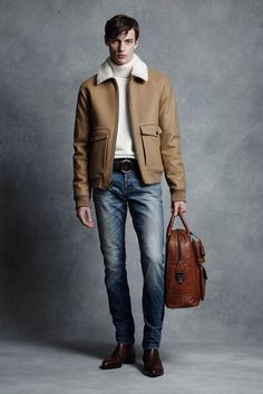 Sand leather shearling bomber jacket, white crewneck sweater, jeans, weekend