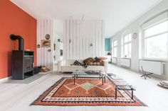 DIFFERENT COLORED ACCENT WALLS - Red orange accent wall   10 Favorite Accent Walls   Remodelista