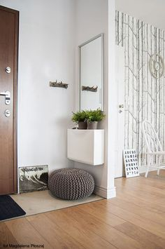 Small space foyer - has the essentials - mirror, cabinet for keys, etc., seating and coat rack.