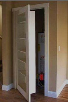 Concealed door behind a shelf.