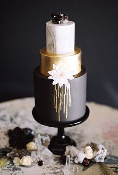 Marble, Gold, and Black Modern Wedding Cake | Brides.com #ModernWeddingIdeas