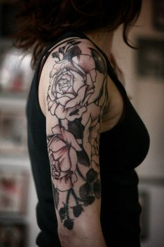 Roses Tattoo. I want a flower b&w half sleeve one day...