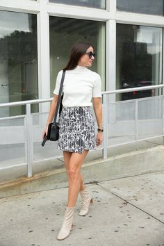 An asymmetrical skirt with leather booties can take the fashion-forward girl from the work-place to drinks with friends.