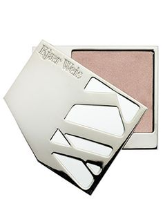 Top splurges: Kjaer Weis Highlighter in Radiance makes cheekbones look like they're bathed in candlelight