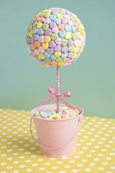 This candy heart topiary will add a sweet touch to your coffee table.