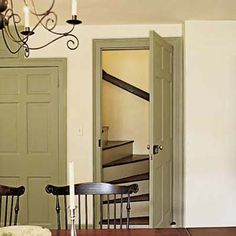 From the dining room, one staircase heads upstairs; another (behind the closed door), down.