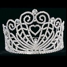Your little girl will love this special tiara. This silver tiara adorned with quality rhinestones features a heart design surrounded by swirls of sparkle. An adjustable band for the perfect fit. Perfect for pageants, Quinceanera, wedding flower girls, Fi Quinceanera Tiaras, Silver Tiara, Styling Tools, Communion, Swirls, Headpiece, Headbands, Wedding Flowers, Fashion Accessories