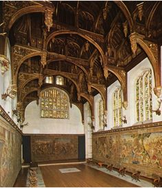 Hampton Court Palace  see the chapel that still has the initials of Anne & Henry on the vaulted ceiling
