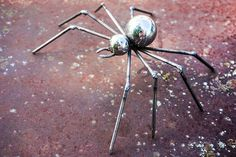 Cool welded spider made from ball bearings and nails.