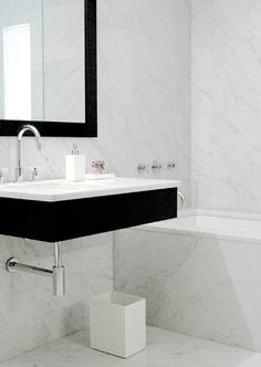 Marble  black  white  do this in the half bath with our soapstone or left over marble counter