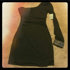 Black one sheer sleeve sleeve body con dress Black size large has small hole by seam under arm smaller than the top of a pencil. New with tags never worn Ruby Rox Dresses