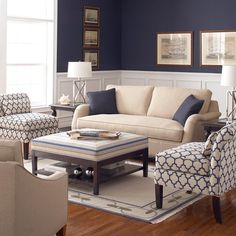 Wainscoting, neutral couch, statement chairs