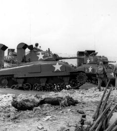 M4A1 medium tanks with 75mm guns go ashore on Kwajalein Island during the Battle of Kwajalein; Marshall Islands - 1944
