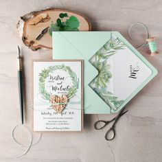 mint green and calligraphy wedding invites