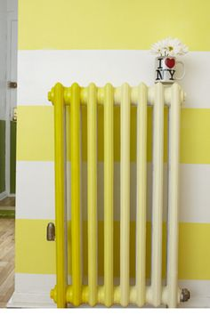 "14 Stylish Solutions To Small-Space Living: """"Make every inch count by turning eyesores into pop art by painting the radiator,"" Lee suggests.""    BUT HOW?"