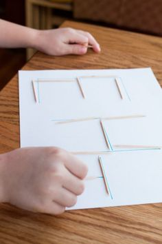 Tracing letters with toothpicks