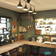 What a neat craft room - love the way they used the windows for storage areas.