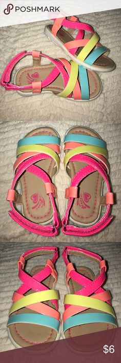 Bright fun neon strappy sandals - size 5 These bright fun neon sandals are from The Children's Place.  Perfect for spring and summer.  The soles are non-marking rubber.  Velcro closure, size 5.  No tags, but these were never worn. Children's Place Shoes Sandals & Flip Flops