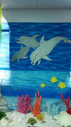 Dolphins hand painted by Lauren Williams