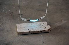 Nina Canell, Flat Earth [detail], 2009. Stepping stone, neon, cable, 1000V, dimensions variable.