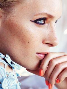 plum eyeliner and orange nails