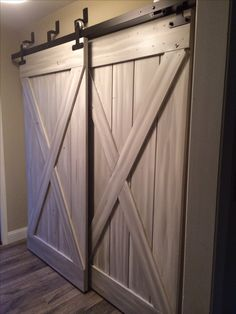 replace the ugly closet doors with sliding barn doors