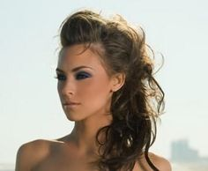 http://images.luvimages.com/luvphotos/m/messy_side_ponytail_and_poof-4368.jpg