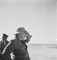 CAMPAIGN NORTH AFRICA 1940-1943 MR CHURCHILL VISITS WESTERN DESERT (E 15299) Prime Minister, Mr Winston Churchill wearing sun helmet, viewing the Alamein position.