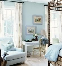 Love the white desk and blue walls
