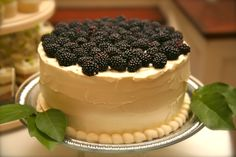 Simple and absolutely beautiful is how we feel about this Keylime Cake accented with fresh Blackberries. Created by Arthur's Catering