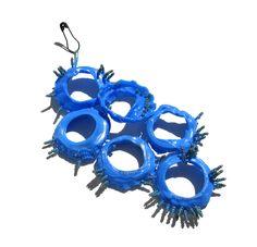 Paula Lindblom. Brooch: Untitled, 2014. Everydaylife plastic, plastic tube, glass beads, safety pin.