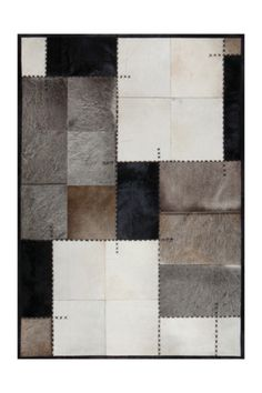 This is a really cool rug for light hardwood or really dark stained hardwood floors. (Surya Texas Cowhide Rug)