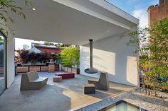 Fabulous terrace with a fireplace and reflecting pool in a SoHo Penthouse by SA-DA Architecture