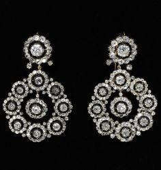 Pair of earrings, brilliant-cut diamonds open-set in silver backed in gold in a rosette design, England, about 1860. Distinctions of rank, age, occasion and dress determined what jewellery could be worn and when. One etiquette manual stated that diamonds, pearls and emeralds were for full evening wear only. In the daytime, women were expected to wear less elaborate jewellery.