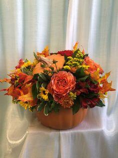 Beautiful autumn arrangement in a porcelain pumpkin with lid