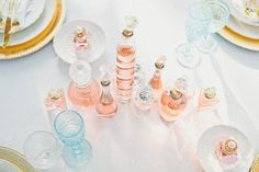 variety of different perfume bottles instead of traditional floral centerpieces - antique vibe