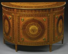 AN IMPORTANT AND RARE PAIR OF GEORGE III SATINWOOD, HAREWOOD AND MAHOGANY MARQUETRY COMMODES ATTRIBUTED TO MAYHEW AND INCE CIRCA 1775