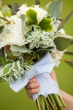 darling white wedding bouquet with blue seersucker ribbon