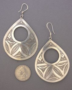 Africa |  A pair of exquisite contemporary Tuareg sterling silver earrings. The silverwork of these nomadic tribesmen is often characterized by geometric patterns which are thought to protect the wearer against the forces of bad magic.