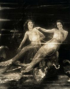 "Actresses Lillian Roth and Frances Dee dressed as lovely mermaids of  the sea. Frances Dee (right) appears opposite Maurice Chevalier in his  new production ""Playboy of Paris"", and Lillian Roth (left)  plays Jack Oakie's leading lady in ""Sea Legs"". ca. 1930  Hollywood, Los Angeles, California, USA"