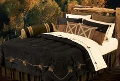 """HiEnd Accents Black Pine Bedding, King by HiEnd Accents. $329.00. 7 pc embroidered bedding set, 110""""x96"""" comforter, 21""""x34""""+3"""" pillow sham(2pcs), 18""""x18"""" cushion(2), 7""""x21"""" neckroll, 78""""x80""""+18"""" dust ruffle. Black pine embroidered micro-suede comforter, moss green skirt, faux leather shams, sherling trimmed accessory pillows and neckroll. Complete bed-in-bag, dry clean. Black Pine Bedding in Super King Size. Black pine embroidered micro-suede comforter, moss gr..."""